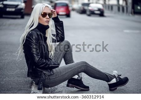 Beautiful blonde model posing outdoors - stock photo