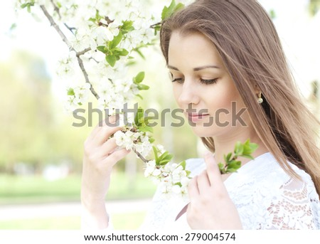 beautiful blonde on a sunny day in the park - stock photo