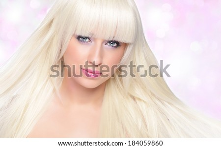 Beautiful blonde over pink background - stock photo