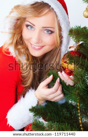 Beautiful blonde portrait with christmas pine