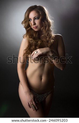 Beautiful blonde posing nude in jewelry