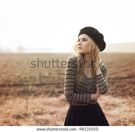 beautiful blonde posing on a sunny day - stock photo