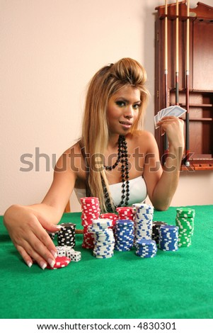 Beautiful blonde showing off her winnings in poker