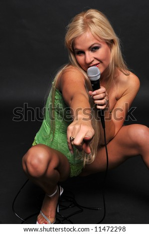 Beautiful blonde singing in lime green bustier and panties