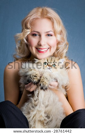 Beautiful blonde smiling woman with fluffy cat - stock photo