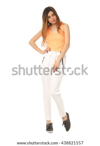 Beautiful blonde teenager in comfortable pants isolated on white