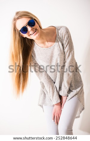 Beautiful blonde, trendy girl with sunglasses is smiling. - stock photo