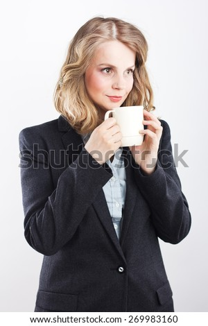 Beautiful blonde with a white cup. coffee break .woman isolated on white background studio portrait. Tea party. Isolated on white. Portrait of a beautiful blonde - stock photo