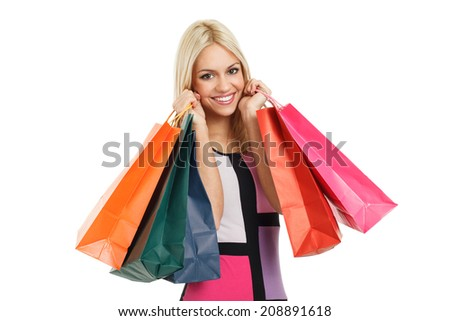 Beautiful blonde with shopping bags - stock photo
