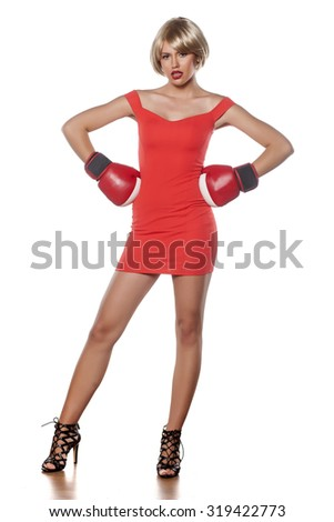 beautiful blonde with short hair posing with boxing gloves