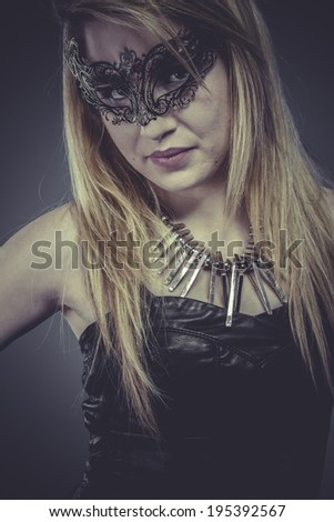 Beautiful blonde with silver jewelry and mask