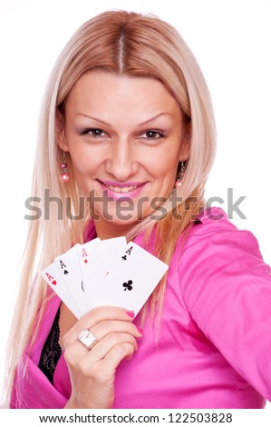Beautiful blonde with smile on the face holding four aces in the hand, isolated on white - stock photo