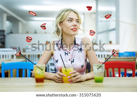 Beautiful blonde with three different cocktails surrounded by ab - stock photo