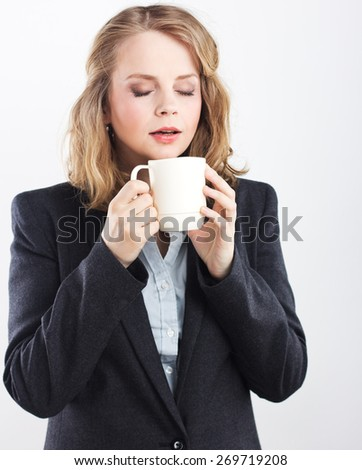 Beautiful blonde with white cup. coffee break .woman isolated on white background studio portrait. Tea party. Isolated on white. Portrait of a beautiful blonde - stock photo