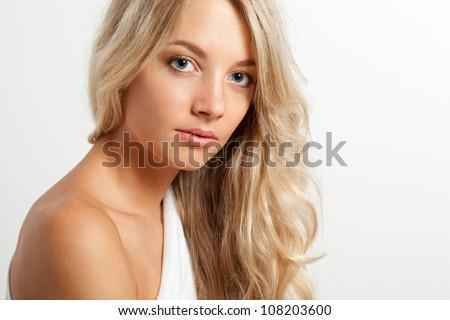 beautiful blonde woman closeup face portrait, copy space for text - stock photo