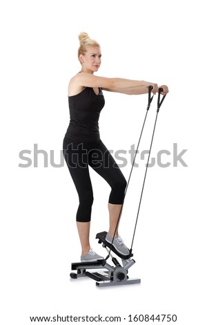 Beautiful blonde woman exercise biceps on twist step device, studio shots 2
