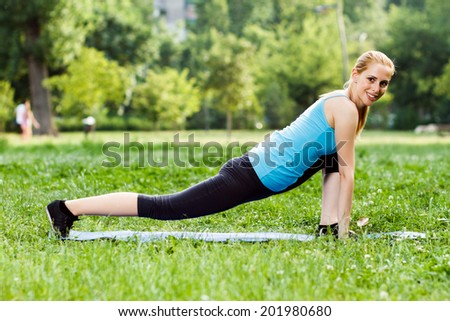 Beautiful blonde woman exercising in the park,Exercise