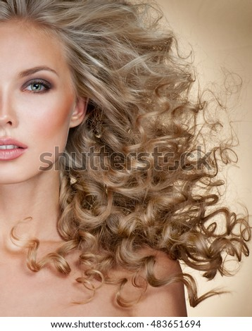 Beautiful blonde woman. Healthy Long Blond Hair. Curly Hair.   Blond, permed Hair