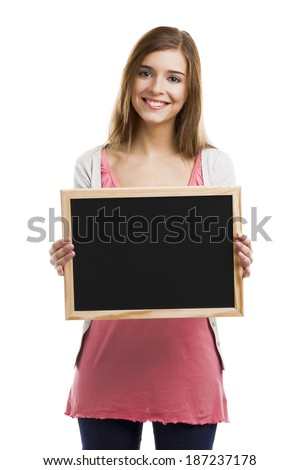 Beautiful blonde woman holding  a chalkboard, isolated over white background - stock photo