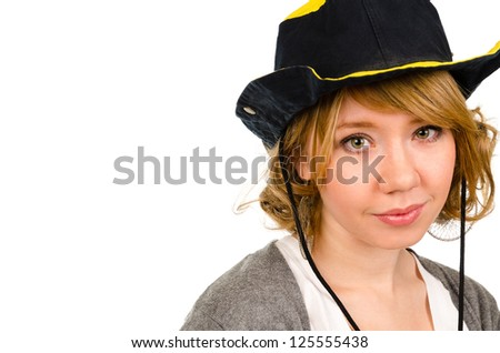 Beautiful blonde woman in a Western cowboy hat looking at the camera, closeup head and shoulders studio portrait isolated on white with copyspace - stock photo