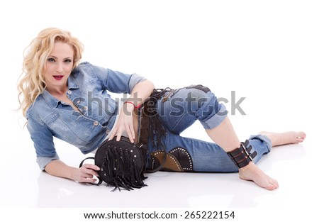 Beautiful blonde woman in nice clothes posing in the studio