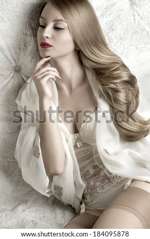 Beautiful blonde woman in white lingerie - stock photo