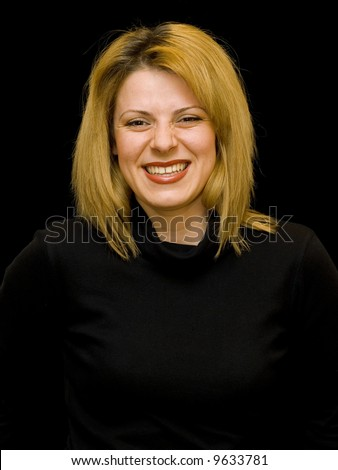 beautiful blonde woman laughing on black background