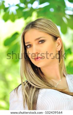 Beautiful blonde woman outdoors - stock photo