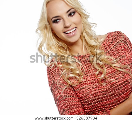 Beautiful blonde woman portrait in autumn color. Studio shoot - stock photo