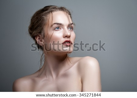 Beautiful blonde woman portrait with make-up, close-up - stock photo