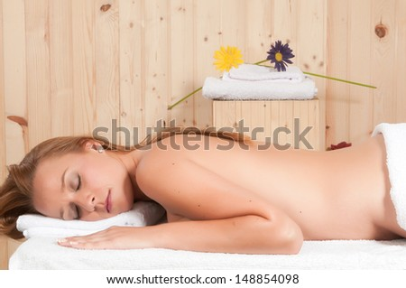 beautiful blonde woman relaxing in spa - stock photo
