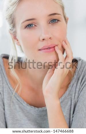 Beautiful blonde woman smiling at the camera - stock photo
