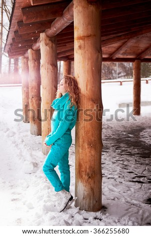 Beautiful blonde woman standing with eyes closed  wearing skates