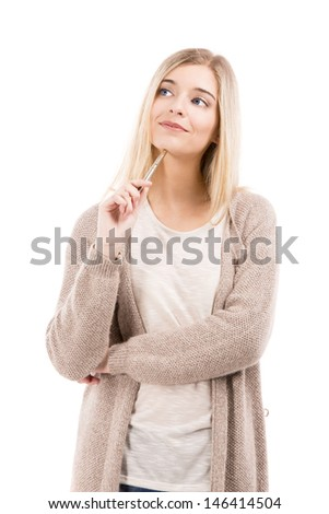 Beautiful blonde woman thinking while holding a pen, isolated over white background - stock photo