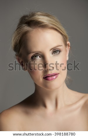 Beautiful blonde woman wearing natural makeup