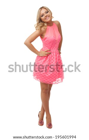 beautiful blonde woman wearing pink dress and shoes isolated on white  - stock photo