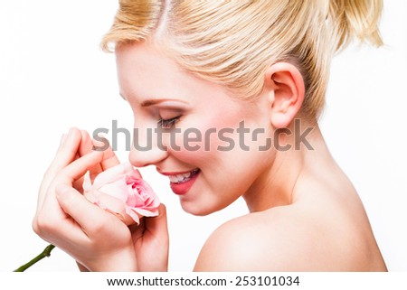 beautiful blonde woman with a rose - stock photo