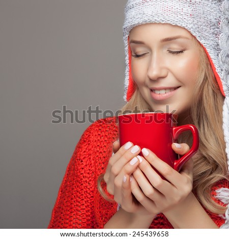 Beautiful blonde woman with an aromatic hot coffee in hands. - stock photo