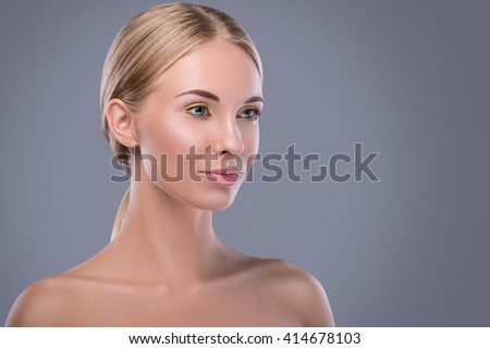 Beautiful blonde woman with bright makeup in studio