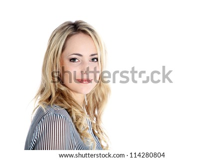 Beautiful blonde woman with copyspace Head and shoulders portrait o a beautiful blonde woman standing sideways facing the camera with large white copyspace - stock photo