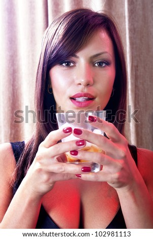 beautiful blonde woman with glass of whisky