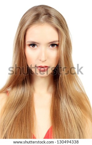 Beautiful blonde woman with magnificent long hair. Isolated over white.