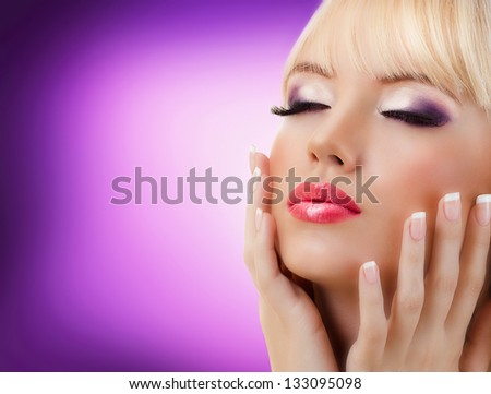 Beautiful blonde woman with manicure and purple makeup - stock photo