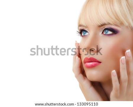 Beautiful blonde woman with manicure and purple makeup on white background - stock photo
