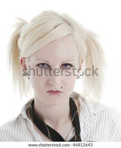 Beautiful blonde woman with piercings looking sulky