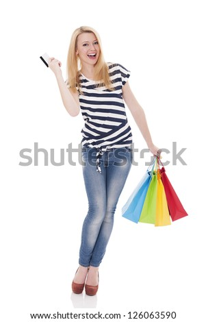 Beautiful blonde woman with shopping bags and credit card - stock photo