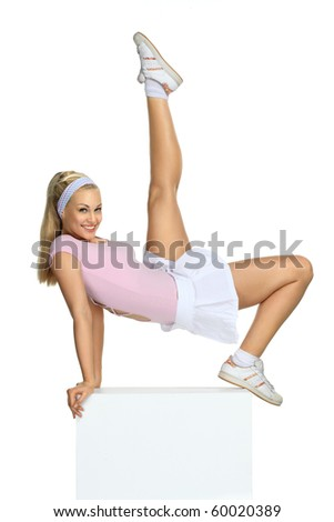 Beautiful blondie girl doing sport exercises - stock photo