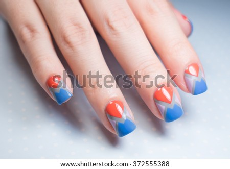 Beautiful blue and pink manicure in light, pantone