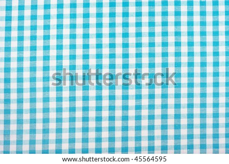 Beautiful blue and white checked gingham tablecloth pattern - stock photo