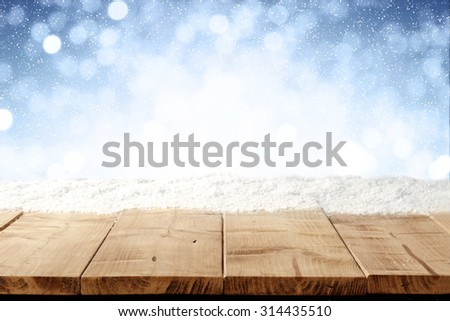 beautiful blue blurred background of winter and yellow wooden table place  - stock photo